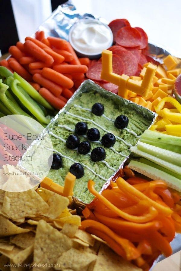 Guacamole with veggies surrounding it