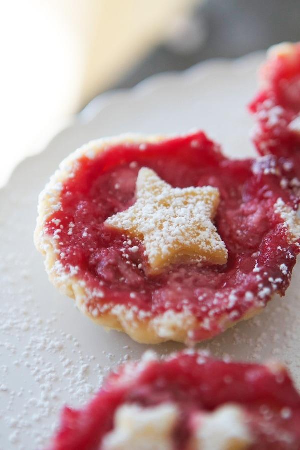A close up of a mini cherry pie