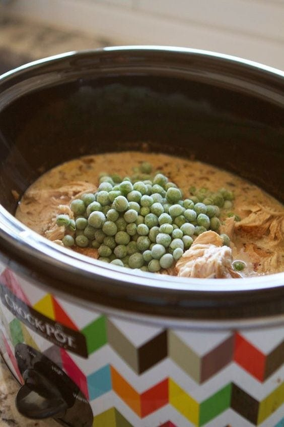 Peas in crockpot full of sauce and chicken