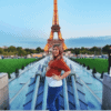 Pregnant Lauren in front of the Eiffel Tower