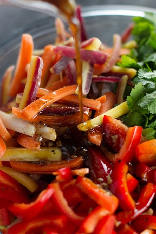 Pouring dressing over vegetables