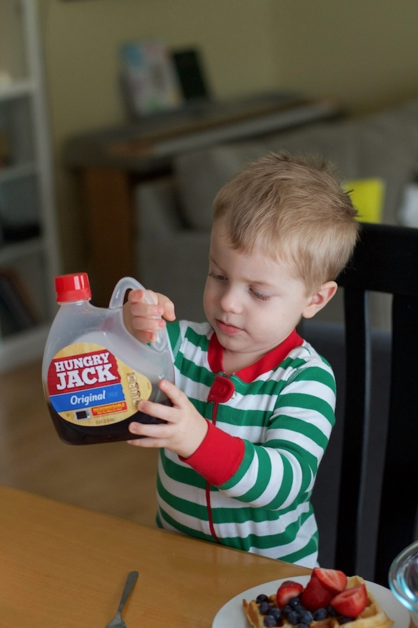 Blake holding Hungry Jack syrup