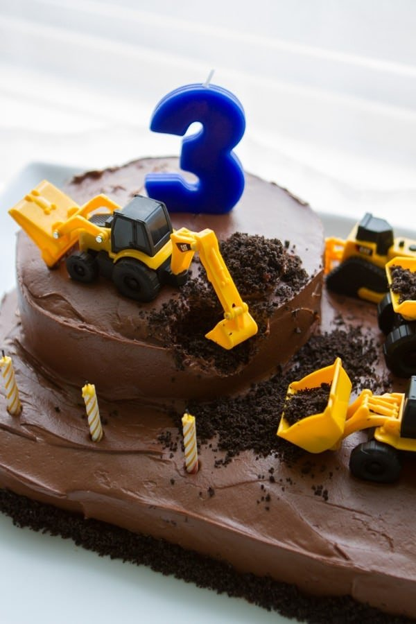 Chocolate cake with dump truck toys