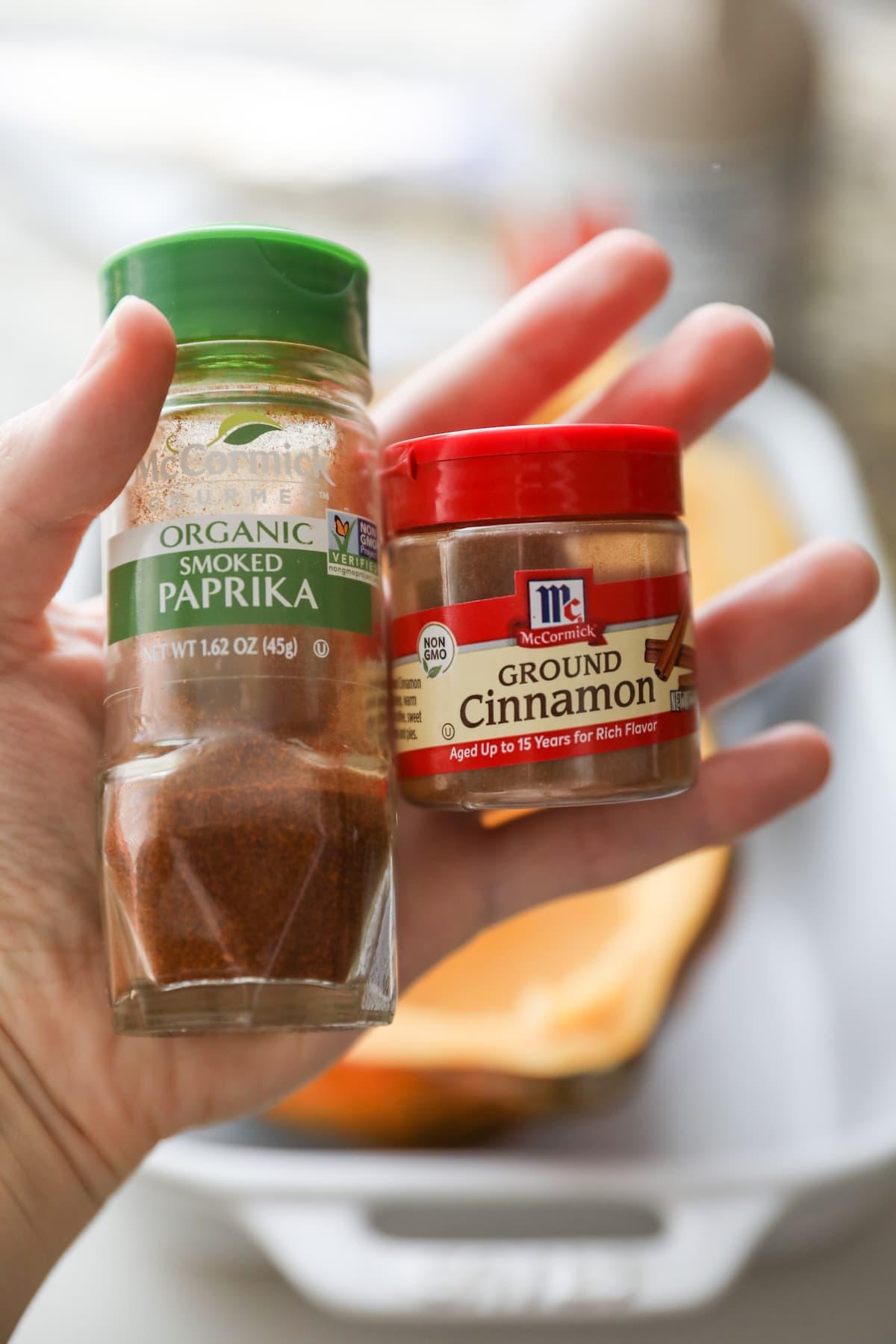 hand holding spice jars