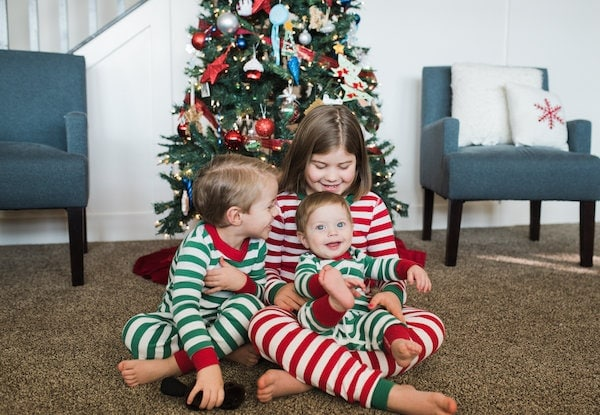 Brennan kids in front of a Christmas tree