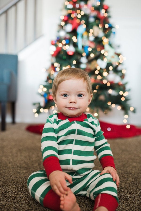 Eddie in front of a christmas tree