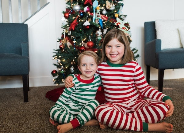 Blake and Brooke in front of a Christmas tree