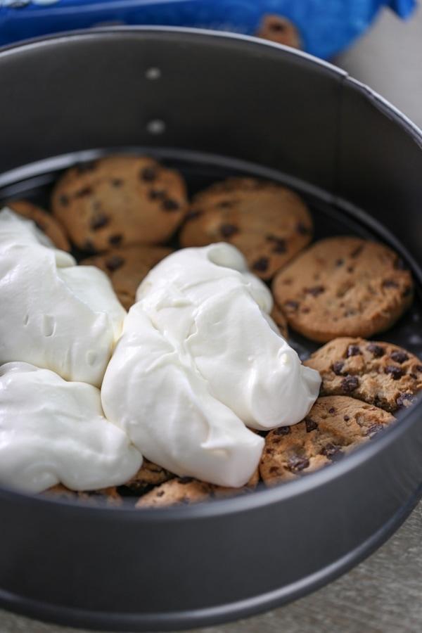 Layering cream mixture over cookies