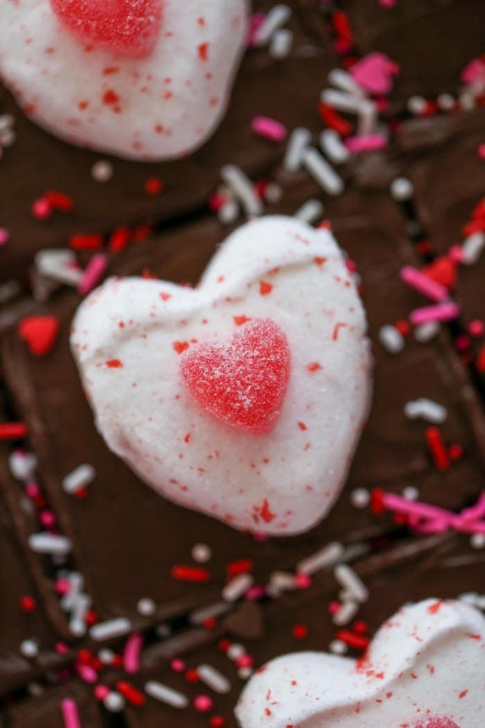 Valentines Day Brownies with frosting, sprinkles and candies on top