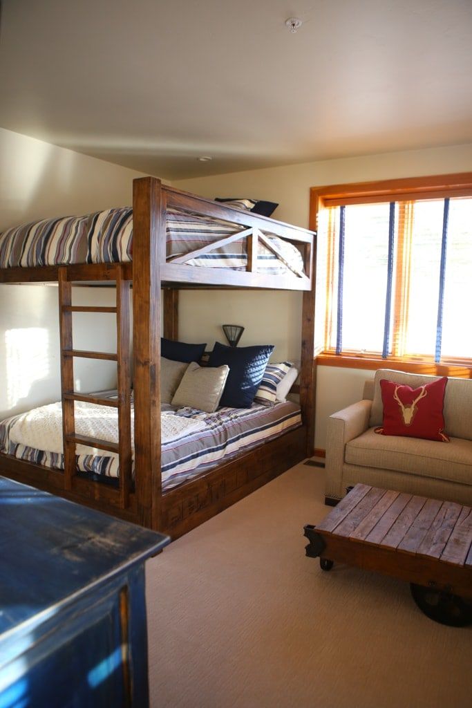 A bedroom with a bunk bed