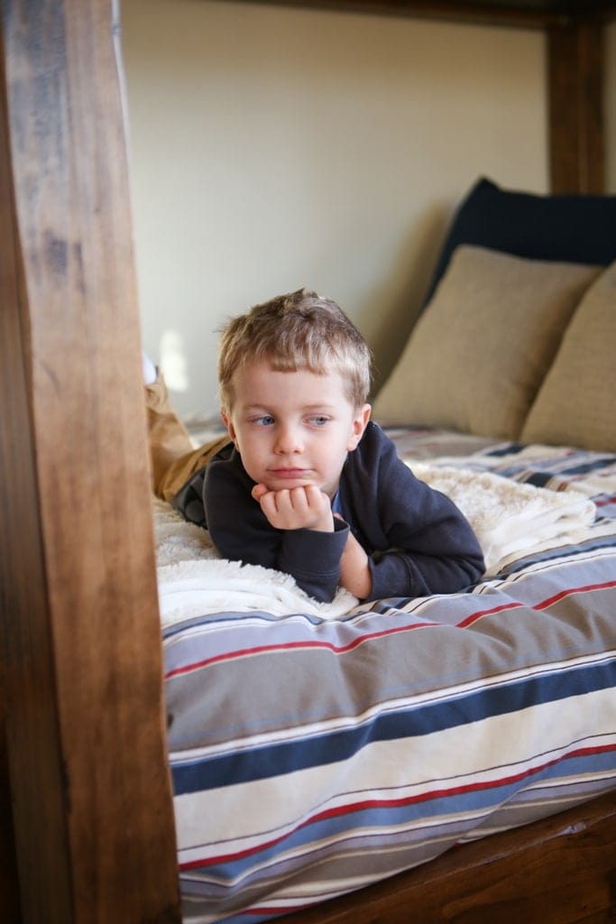 A boy laying on a bed