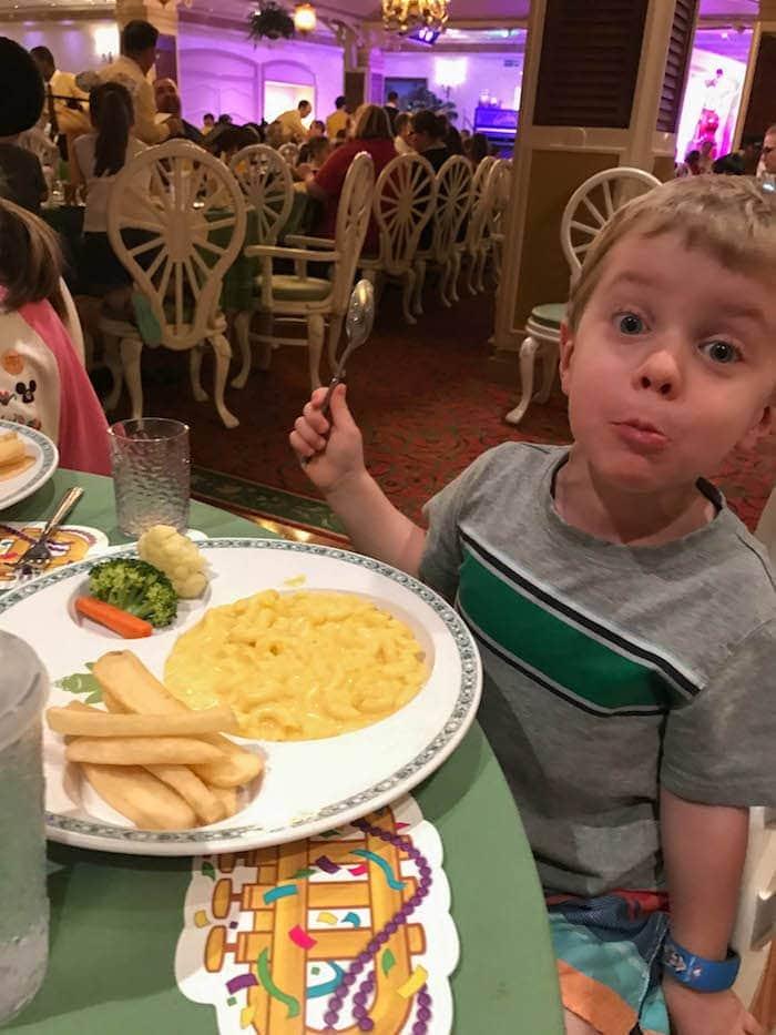 Blake eating at a table