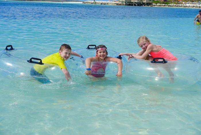 Kids swimming with innertubes