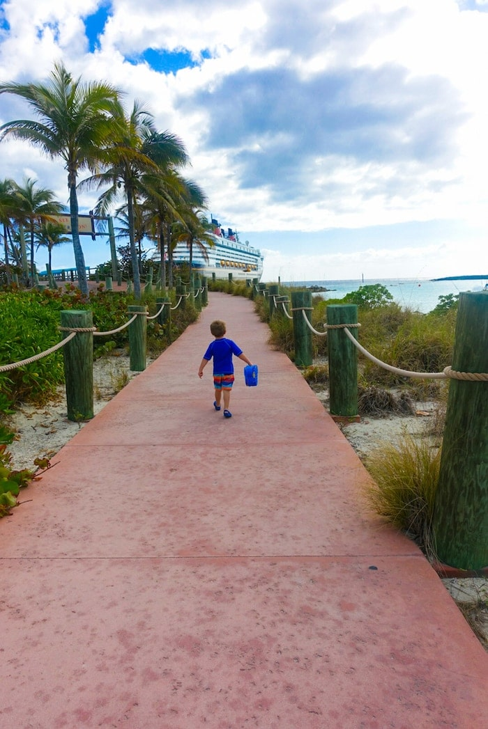 A little boy walking on a path