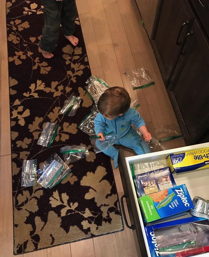 Eddie on the ground with Ziploc bags