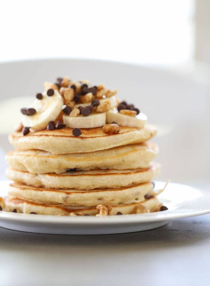 Banana Chocolate Chip Walnut Pancakes are so fluffy, soft and sweet that you might not need syrup! Except totally add syrup.