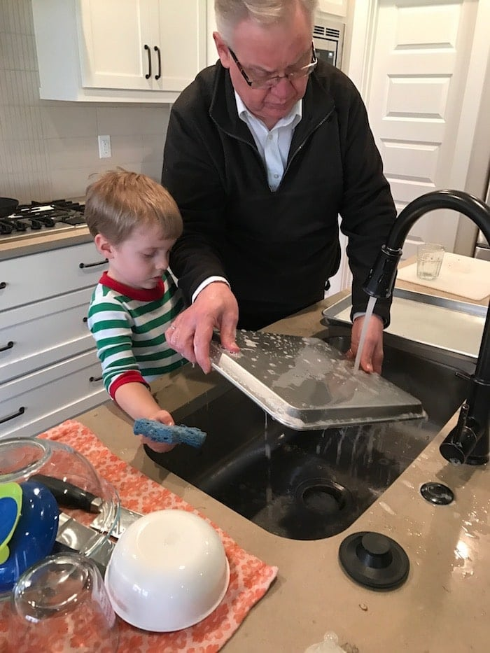 Blake and Grandpa doing dishes