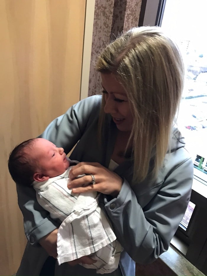 Lauren holding a baby