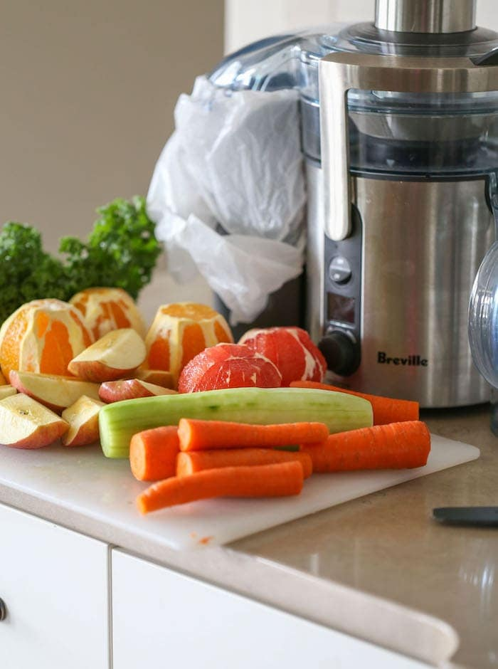 Fruits and Vegetables next to a juicer