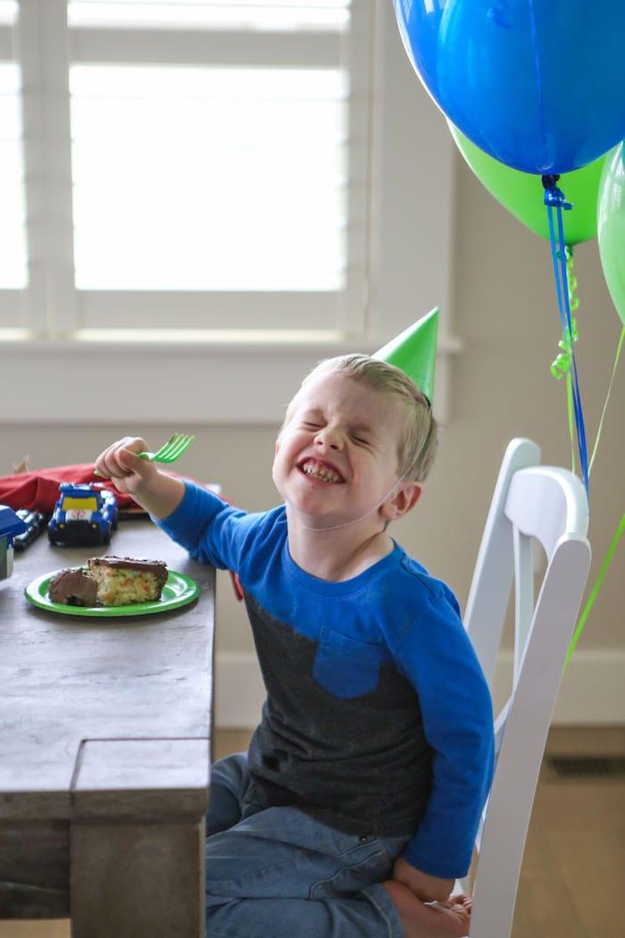 Blake sitting and eating cake