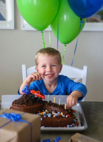 Blake sitting in front of his cake