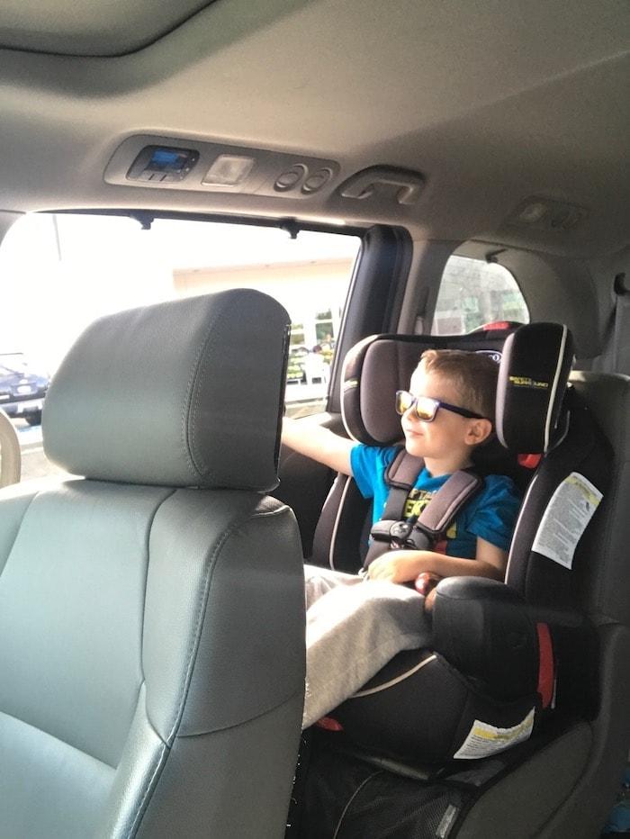Blake in a car seat in a car