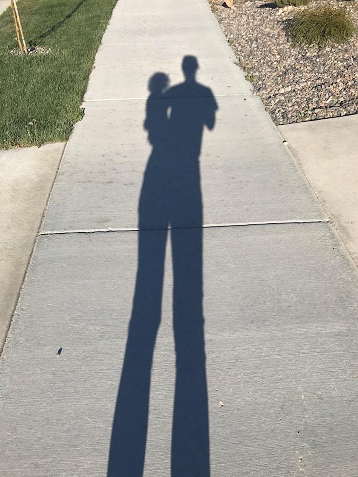 Lauren holding Eddie shadow