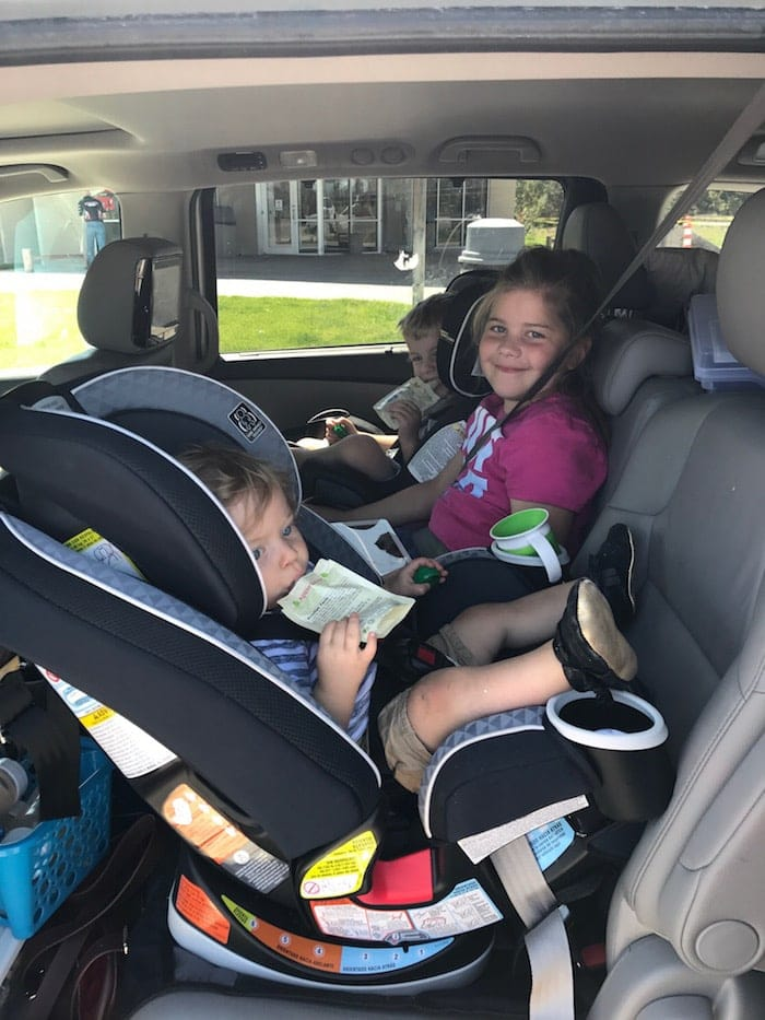 Kids in the back of a car