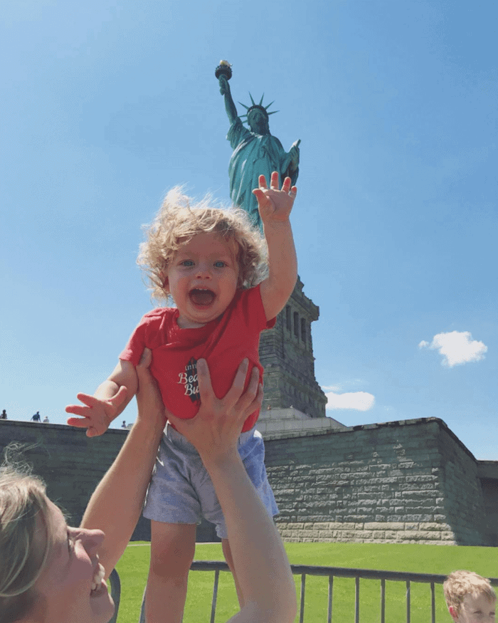 Eddie in front of the statue of liberty