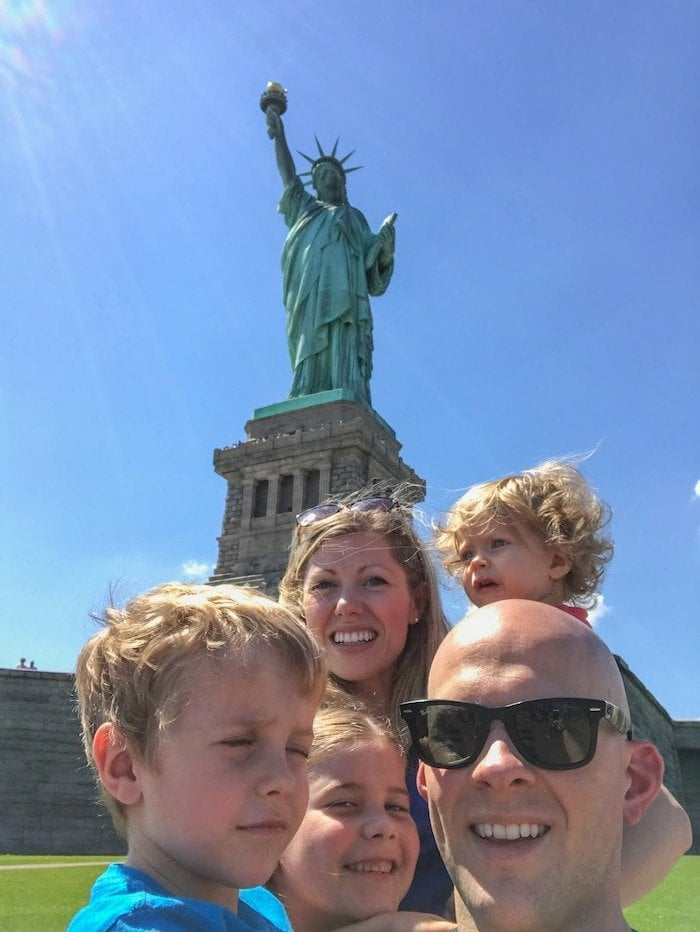 Brennan family in front of the statue of liberty