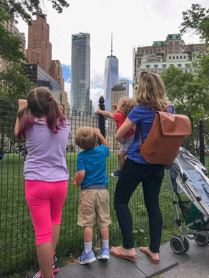 Lauren and the kids looking towards the city