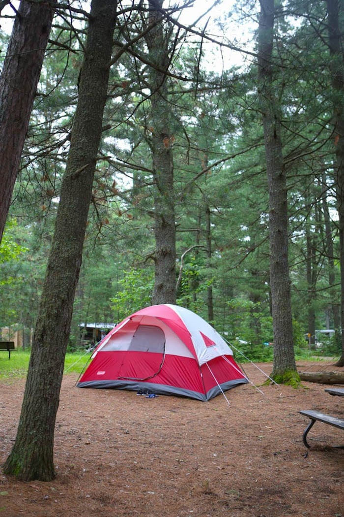 A tent in a wooded area