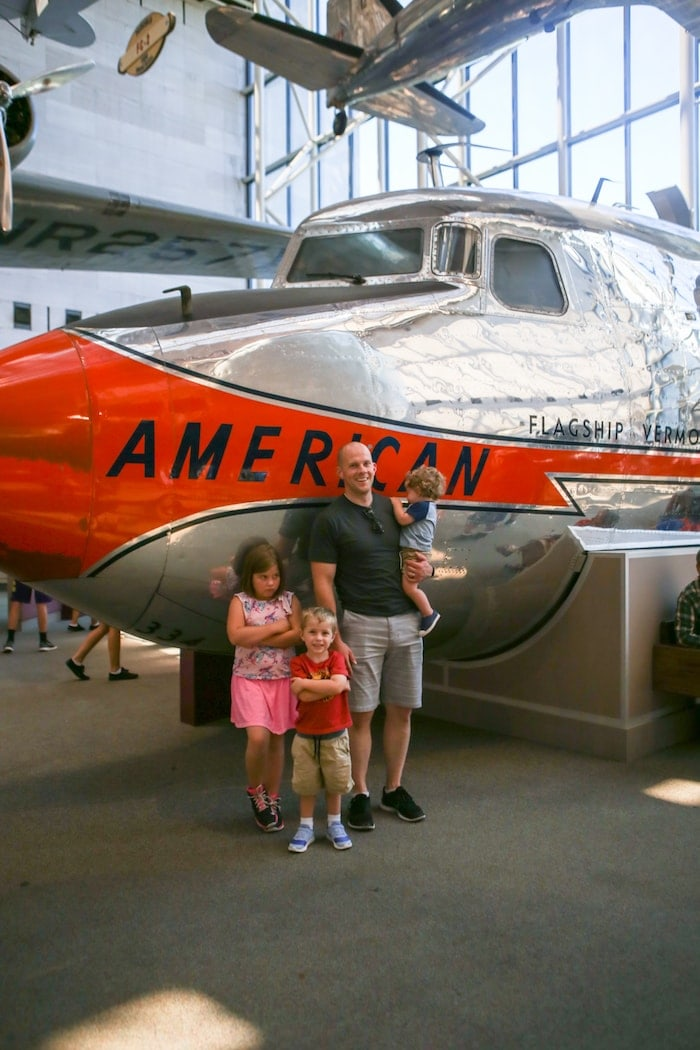 Gordon and the kids in front of a plane