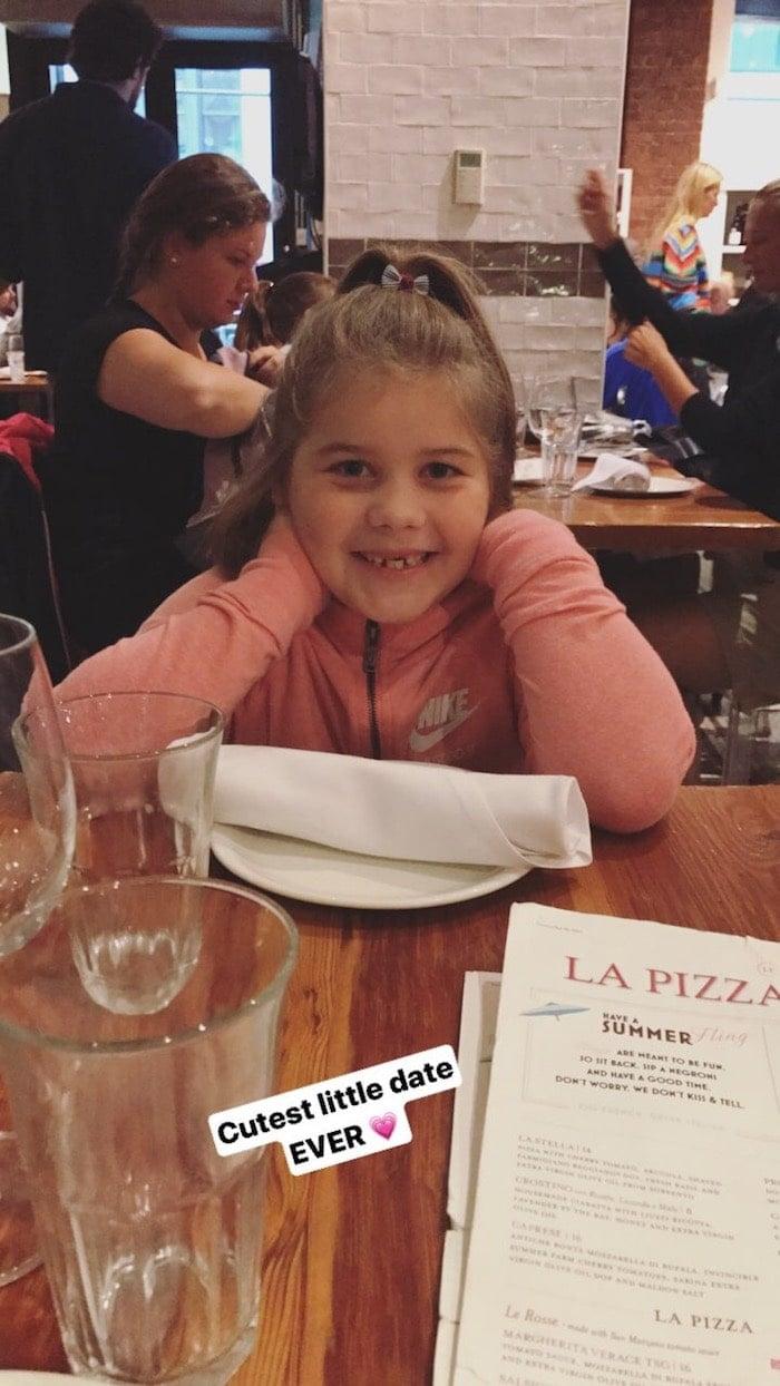 Brooke at a table