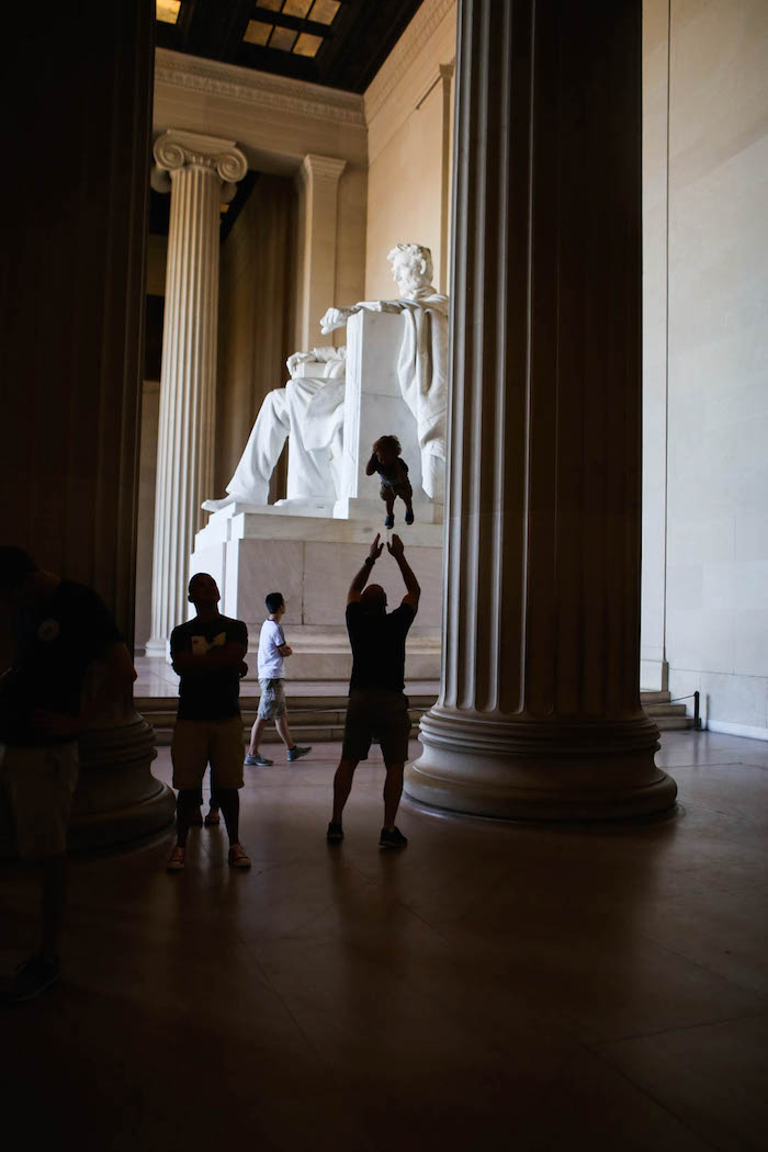 Gordon throwing Eddie up in the air at the Lincoln Memorial