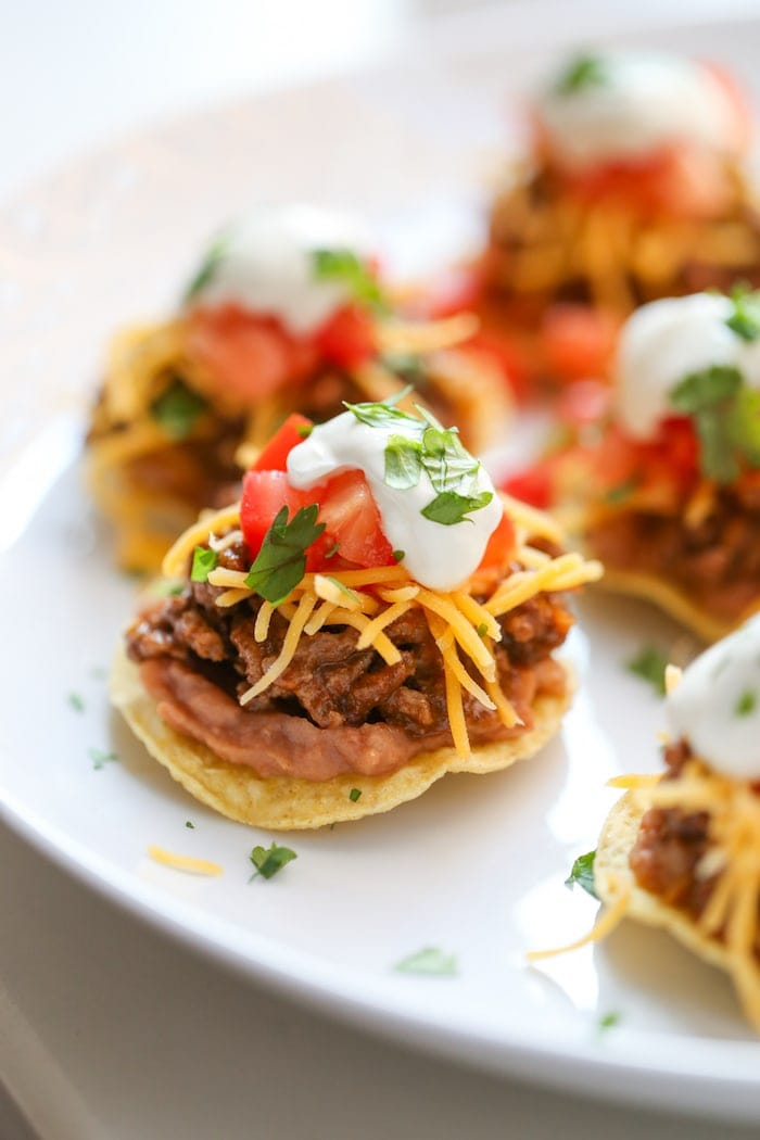 Tostada Bites are cute little appetizers perfect for any party for tailgate! Mini tostadas!! YUM!