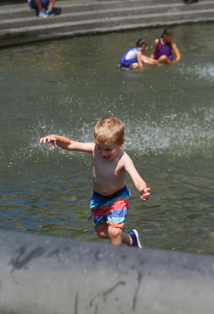 A little boy that is standing in the water