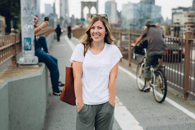 A woman walking down a city street