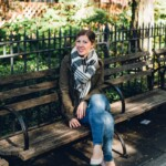 A person sitting on a park bench