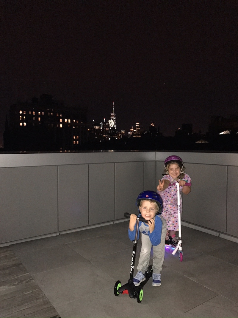The kids on the roof of a building