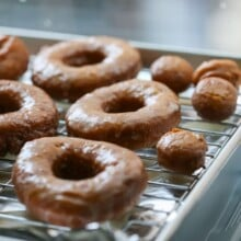 Pumpkin Donuts with glaze on drying rack