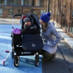 Lauren with Eddie in a stroller