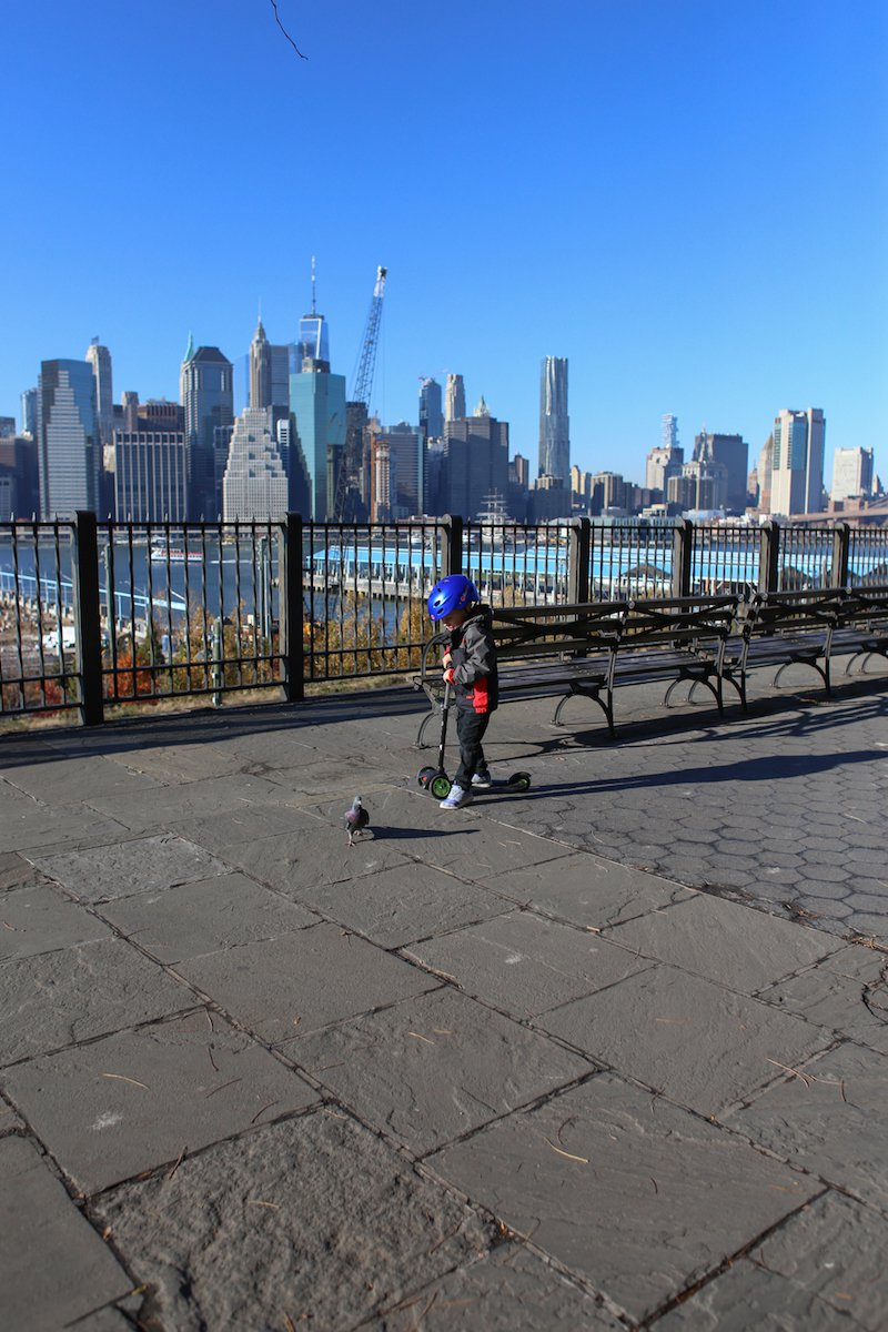 Scootering around with the city in the background