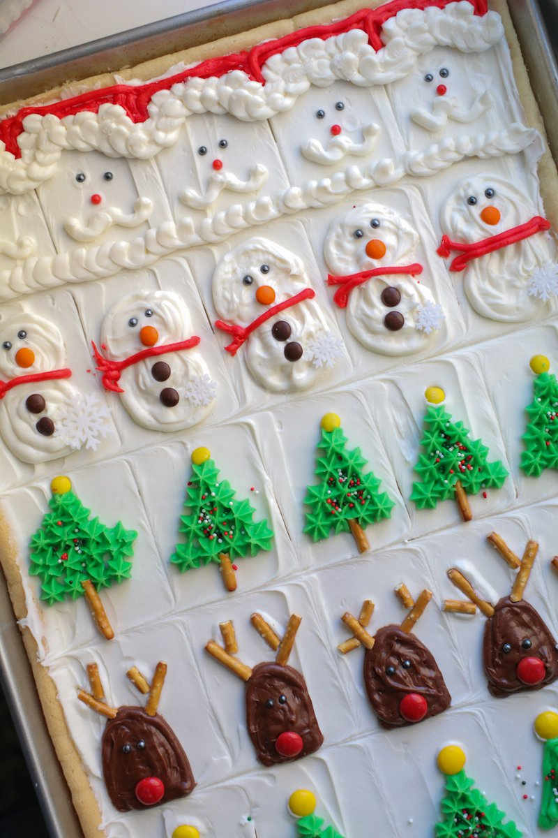 create a beautifully decorated pan of sugar cookie bars that will feed a crowd at christmas they look fancy but couldnt be easier - Decorated Christmas Sugar Cookies