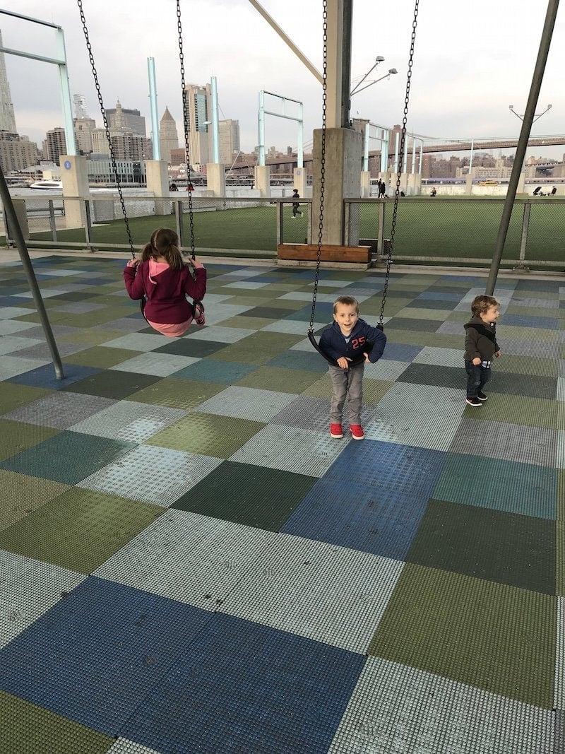 Brennan kids swinging