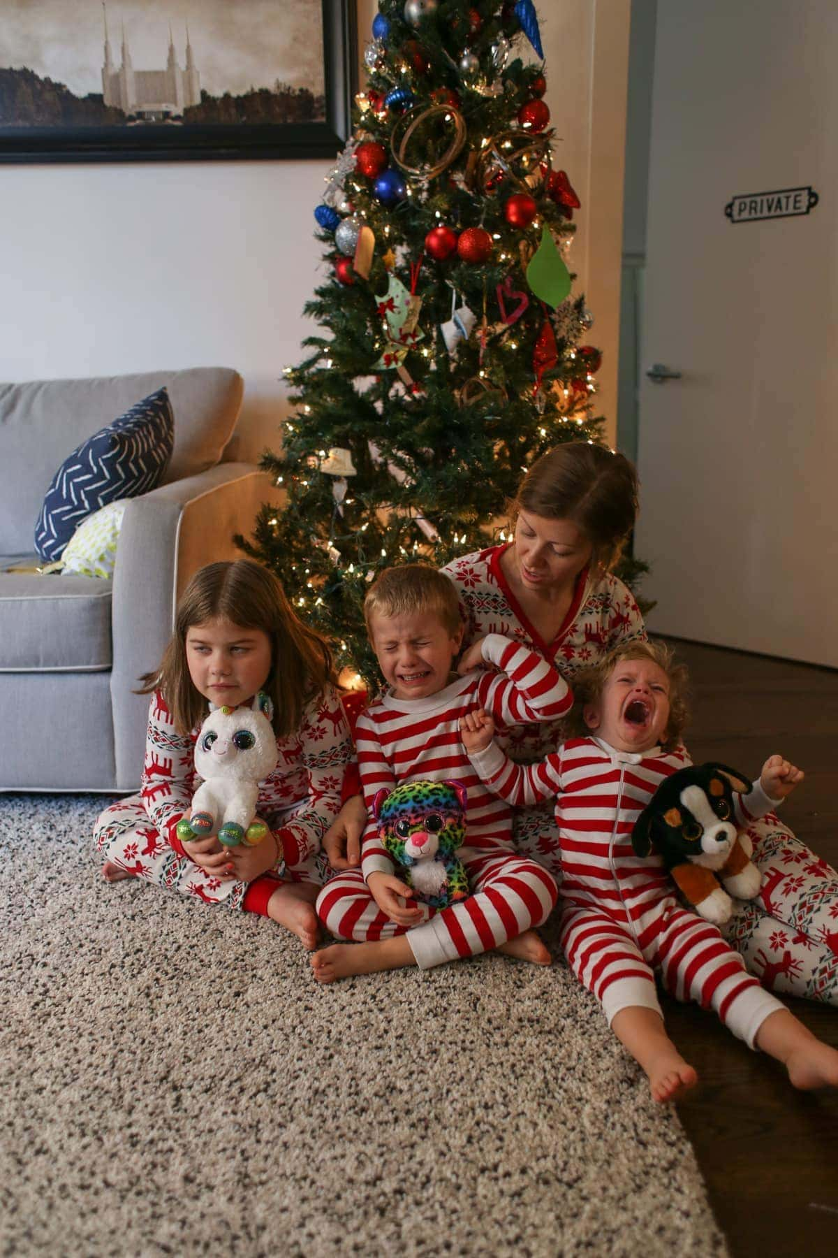 Lauren and the kids in front of the Christmas tree