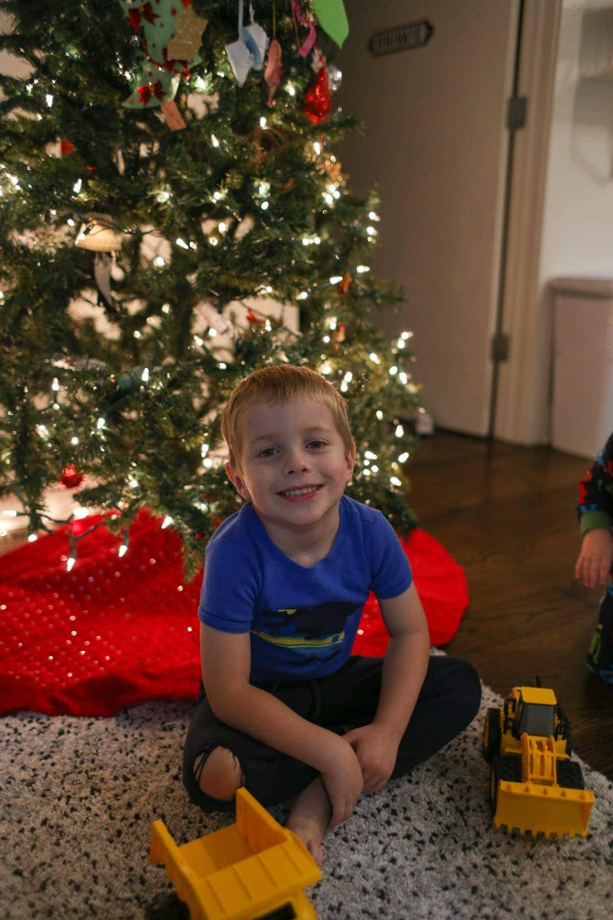 Blake in front of the Christmas tree