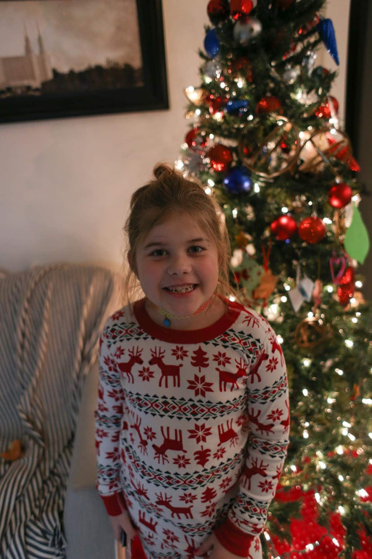 Brooke in front of the Christmas tree