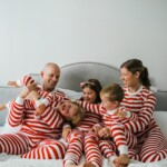 Brennan family in matching pajamas on a bed