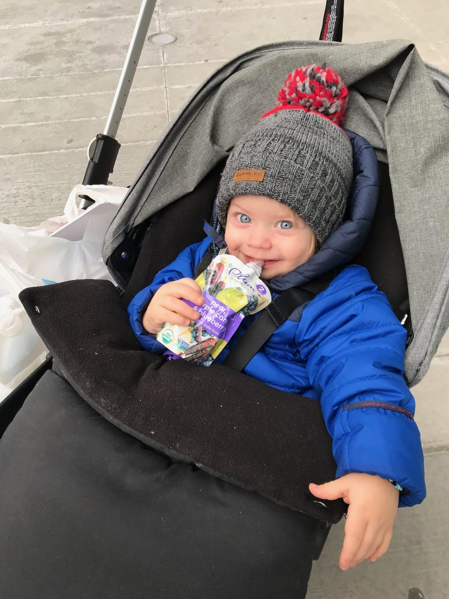 Eddie in the stroller with a snack